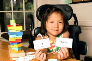 Girl in a wheelchair with flashcards