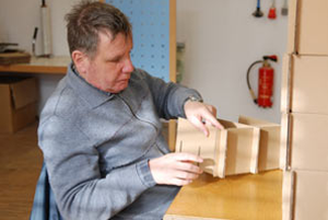Man building a birdhouse